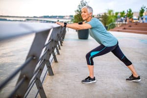 Woman stretching while jogging